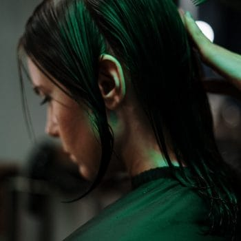woman styling wet hair
