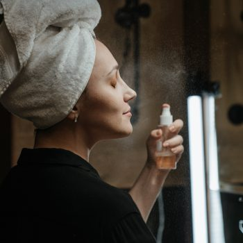 Woman with a beauty spray