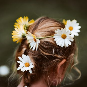 woman with flowers in her hairpiece