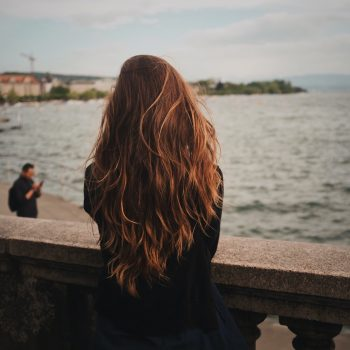 red haired woman on a bridge