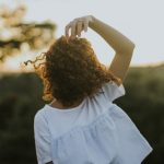 curly haired woman in the sun