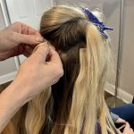 woman attaching hair extensions